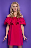Attractive young blonde girl in red dress Stock Photography