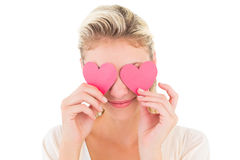 Attractive young blonde holding hearts over eyes Stock Images
