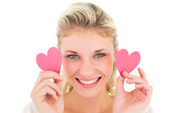 Attractive young blonde holding little hearts Royalty Free Stock Photos