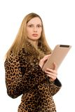 Blonde keeps the tablet pc Royalty Free Stock Photos