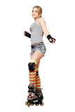 Attractive young blonde on roller skates Stock Photos