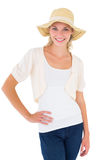 Attractive young blonde smiling at camera in sunhat Stock Photo