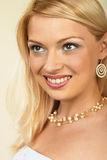 Attractive young blonde woman. Close-up. Stock Photography
