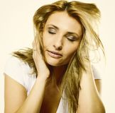 Attractive young blonde woman closed eyes portrait Stock Photo