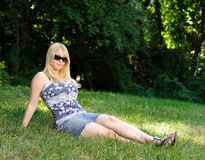 Attractive young blonde woman relaxing outdoors Royalty Free Stock Photos