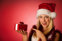Attractive young blonde woman in santa claus dress - christmass Stock Images