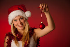 Attractive young blonde woman in santa claus dress - christmass Royalty Free Stock Image