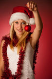 Attractive young blonde woman in santa claus dress - christmass Royalty Free Stock Photography