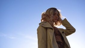 Attractive Young Blonde Woman in Trench with Vintage Suitcase on the Jacht Pier. Parallax effect, Low angle shot. Attractive Young Blonde Woman in Tranch and stock video footage