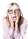 Nerdy woman reacting in horror and fright Royalty Free Stock Images
