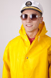 Attractive young boat captain. With rain coat Stock Image
