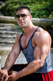 Attractive young bodybuilder outside Royalty Free Stock Photos