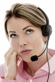 Attractive Young Bored Business Woman Using a Telephone Headset Royalty Free Stock Images
