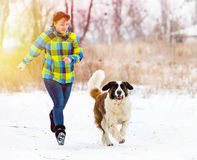 Attractive young boy and girl playing with a dog Royalty Free Stock Image