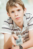 Attractive young boy using a remote control Stock Photo