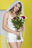 Attractive Young Bride Carrying Flowers Stock Images