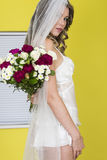 Attractive Young Bride Carrying Flowers Stock Photography