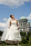 Attractive young bride enjoy sunshine. Stock Images