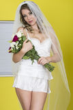 Attractive Young Bride Holding Bouquet of Flowers Royalty Free Stock Photo