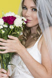 Attractive Young Bride Holding Bouquet of Mixed Flowers Stock Images