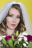 Attractive Young Bride Holding Bouquet of Mixed Flowers Stock Image