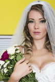 Attractive Young Bride Holding Wedding Flowers Royalty Free Stock Photography
