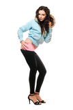 Attractive young brunette in a black leggings Stock Photos