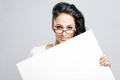 Attractive young brunette with blank sign. Stock Photo