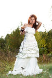 Attractive young brunette bride with chihuahua Stock Photos