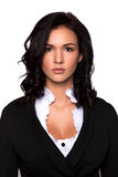 Attractive young brunette businesswoman with her arms crossed royalty free stock photos