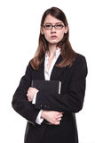 Attractive young brunette businesswoman. Standing with her arms crossed Royalty Free Stock Photos