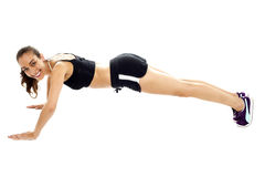 Attractive young brunette doing push ups Royalty Free Stock Images