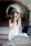 Attractive young brunette with hat posing. stock images
