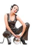 Attractive young brunette in headphones Stock Photography