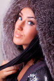 Attractive young brunette in her coat. Attractive young brunette with beautiful blue eyes in her coat Royalty Free Stock Photos