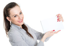 Attractive brunette holding blank card Stock Photo