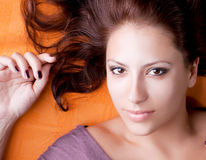 Attractive young brunette model close-up portrait stock images