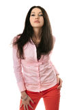 Attractive young brunette in pink shirt Royalty Free Stock Image