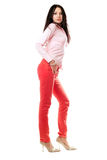 Attractive young brunette in red jeans Stock Images