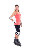 Attractive young brunette on roller skates Royalty Free Stock Photo