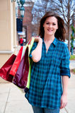 Attractive Young Brunette on Shopping Spree Stock Image