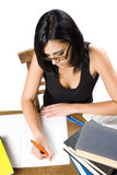 Attractive young brunette student. Stock Images