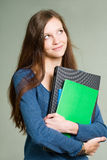 Attractive young brunette student girl. Stock Photos