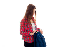 Attractive young brunette students teenager in stylish clothes and backpack in her hands posing isolated on white Royalty Free Stock Photography