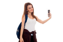 Attractive young brunette students teenager in stylish clothes and backpack on her shoulders posing isolated on white Stock Image