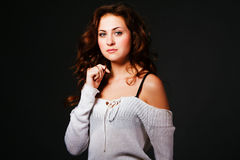 Attractive young brunette in sweater Stock Photo