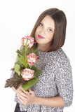 Attractive young brunette woman with bouquet of roses Stock Images