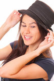 Attractive young brunette woman in a hat Stock Images