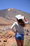 Attractive young brunette woman looking at volcano Teide on Tenerife Stock Photography