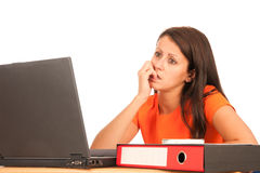 Attractive young brunette working on laptop Royalty Free Stock Photos